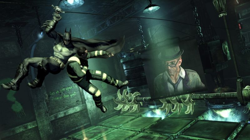 The Riddler watches as you make your way past his 'clever' traps and save one of his hostages.
